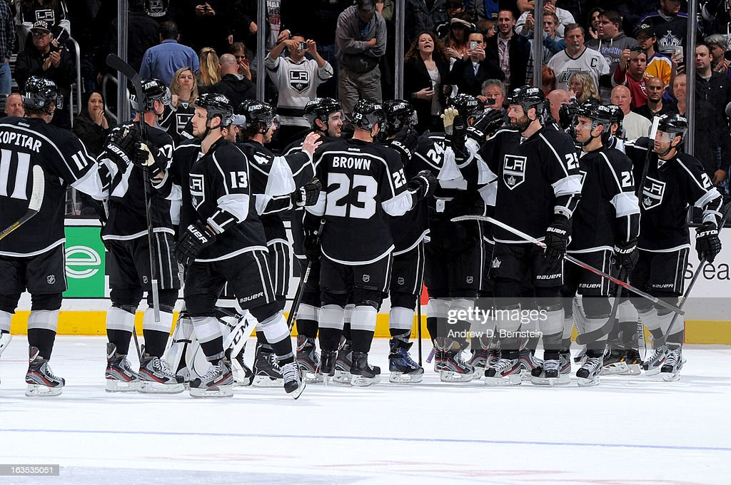 The Los Angeles Kings celebrate after defeating the Calgary Flames at Staples Center on March 11, 2013 in Los Angeles, California.