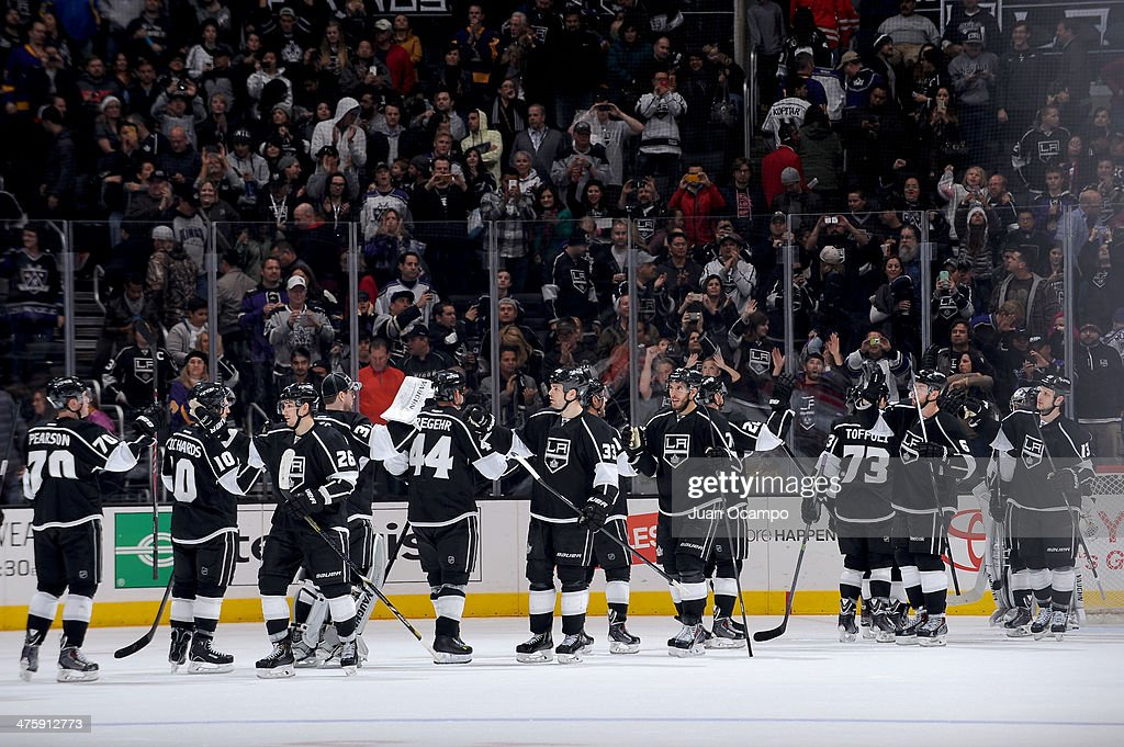 The Los Angeles Kings celebrate after defeating the Carolina Hurricanes at Staples Center on March 1, 2014 in Los Angeles, California.