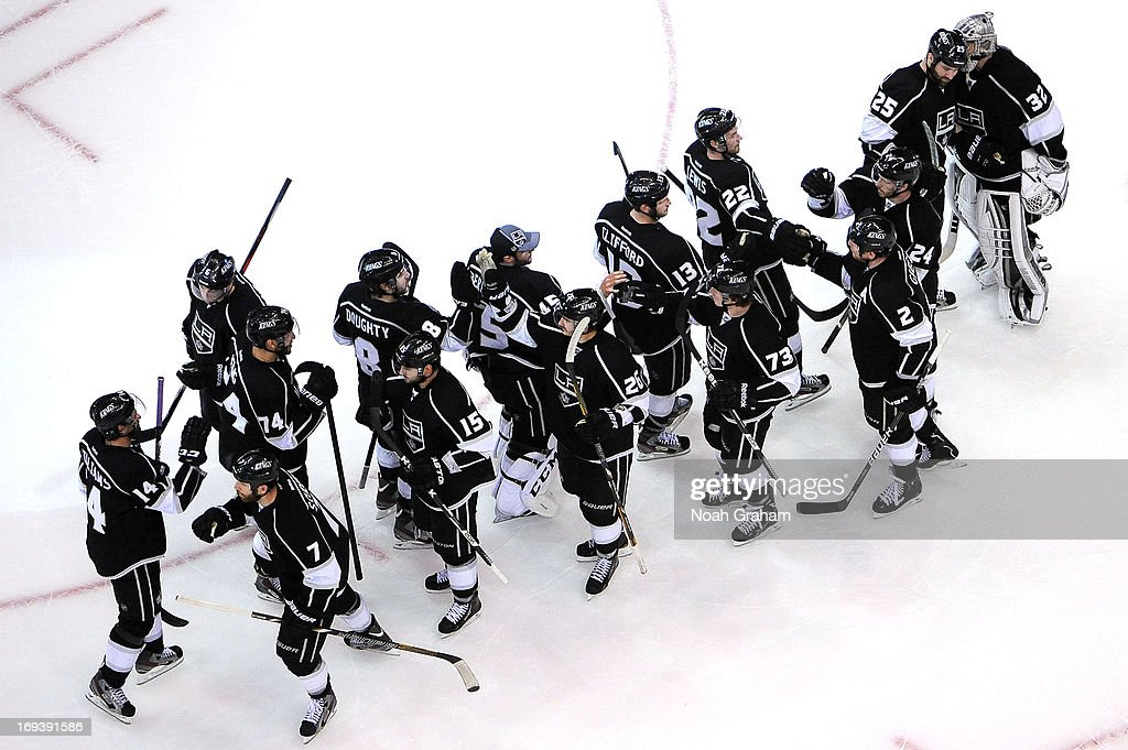 The Los Angeles Kings celebrate after defeating the San Jose Sharks in Game Five of the Western Conference Semifinals during the 2013 NHL Stanley Cup Playoffs at Staples Center on May 23, 2013 in Los Angeles, California.