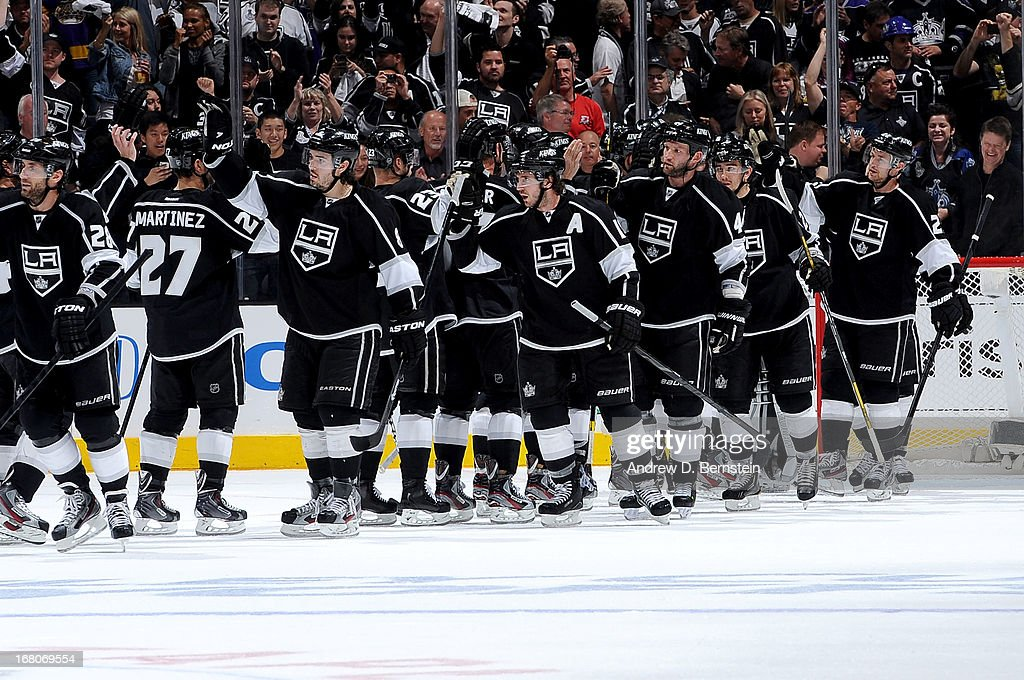 The Los Angeles Kings celebrate after defeating the St. Louis Blues in Game Three of the Western Conference Quarterfinals during the 2013 NHL Stanley Cup Playoffs at Staples Center on May 4, 2013 in Los Angeles, California.