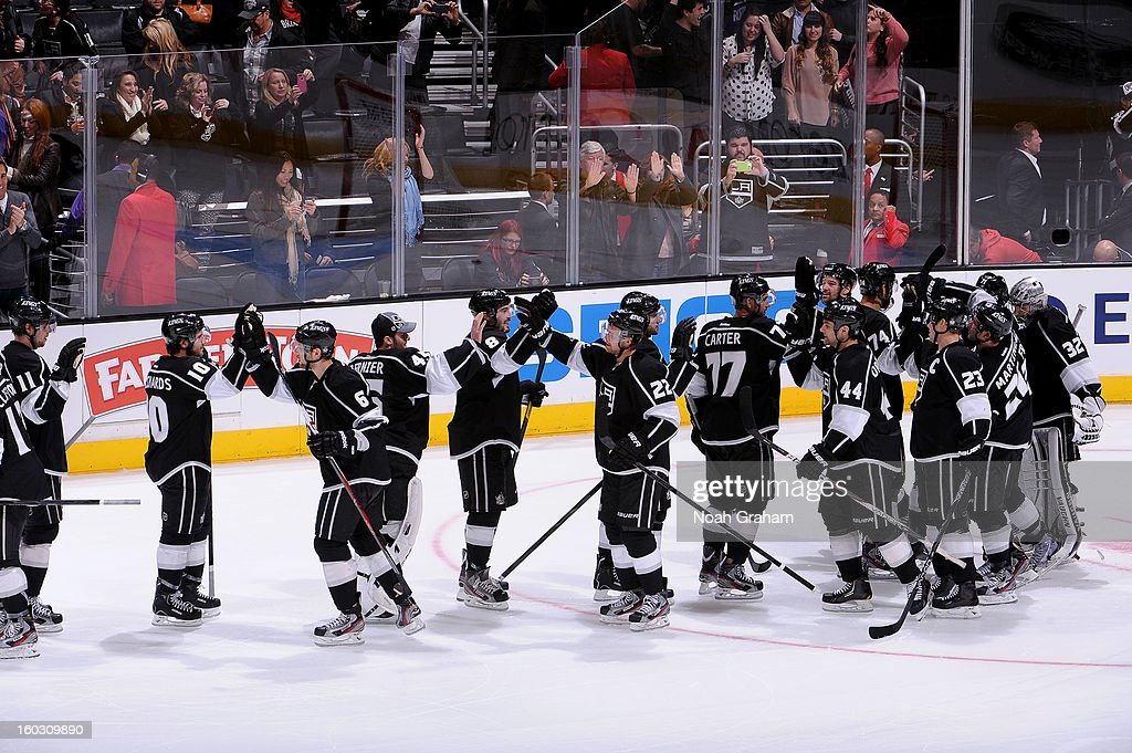 The Los Angeles Kings celebrate after defeating the Vancouver Canucks at Staples Center on January 28, 2013 in Los Angeles, California.