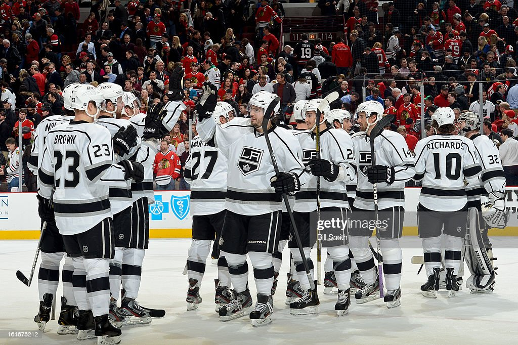 The Los Angeles Kings celebrate after the Kings defeated the Chicago Blackhawks 5 - 4 during the NHL game on March 25, 2013 at the United Center in Chicago, Illinois.