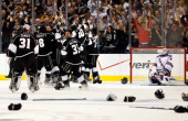 The Los Angeles Kings celebrate winning the Stanley Cup after Alec Martinez scored the gamewinning double overtime goal on goaltender Henrik...