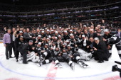The Los Angeles Kings pose for a team photograph after defeating the New York Rangers in the second overtime period of Game Five of the 2014 NHL...
