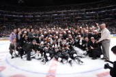 The Los Angeles Kings pose for a team photograph on the ice following Game Five of the 2014 NHL Stanley Cup Final at Staples Center on June 13 2014...