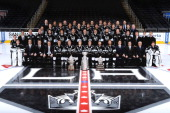 The Los Angeles Kings pose for a team picture with the Stanley Cup Trophy the Conn Smythe Trophy and the Campbell Cup before the Los Angeles Kings...