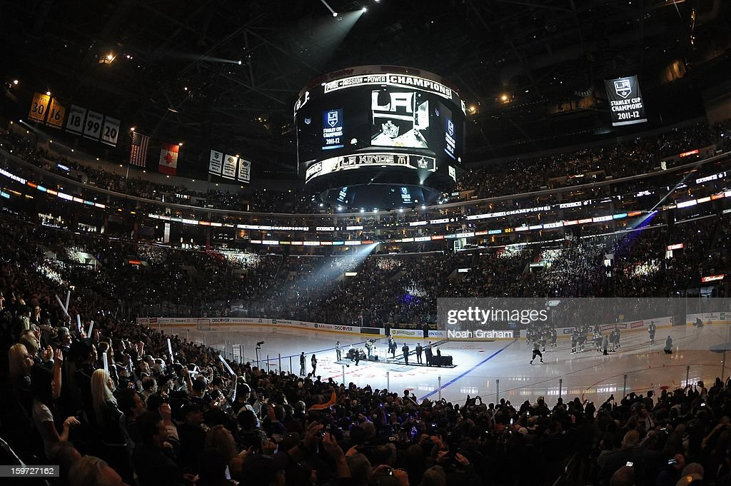 The Los Angeles Kings watch as their 2011-2012 Championship Banner is raised to the rafters prior to the game against the Chicago Blackhawks at Staples Center on January 19, 2013 in Los Angeles, California.