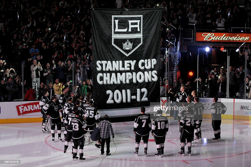 The Los Angeles Kings watch as their 2011-2012 Championship Banner is raised to the rafter prior to the game against the Chicago Blackhawks at Staples Center on January 19, 2013 in Los Angeles, California.