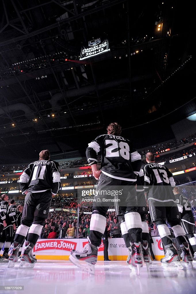 The Los Angeles Kings watch as their 2011-2012 Stanley Cup Championship Banner is raised to the rafters prior to the game against the Chicago Blackhawks at Staples Center on January 19, 2013 in Los Angeles, California.