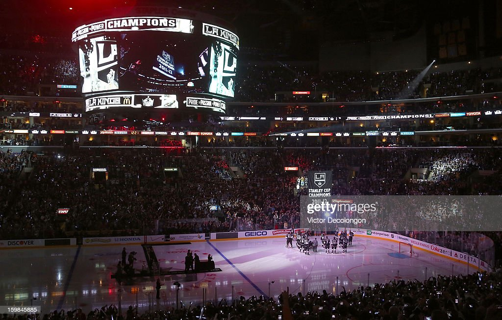 The Los Angeles Kings watch as their 2011-2012 Stanley Cup Championship Banner is raised to the rafters prior to the game against the Chicago Blackhawks at Staples Center on January 19, 2013 in Los Angeles, California. The Blackhawks defeated the Kings 5-2.