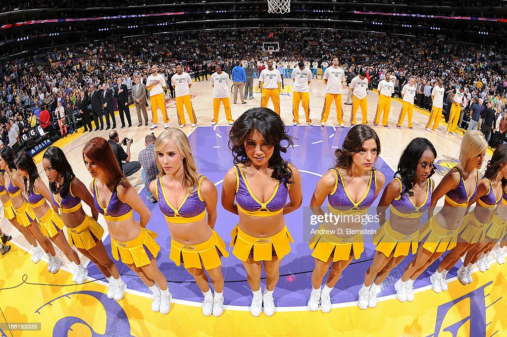 The Los Angeles Laker Girls look on during the performance of the National Anthem before a game between the New Orleans Hornets and the Lakers at Staples Center on April 9, 2013 in Los Angeles, California.