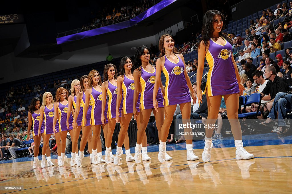 The Los Angeles Laker girls perform a dance during a break against the Golden State Warriors at Citizens Business Bank Arena on October 5, 2013 in Ontario, California.