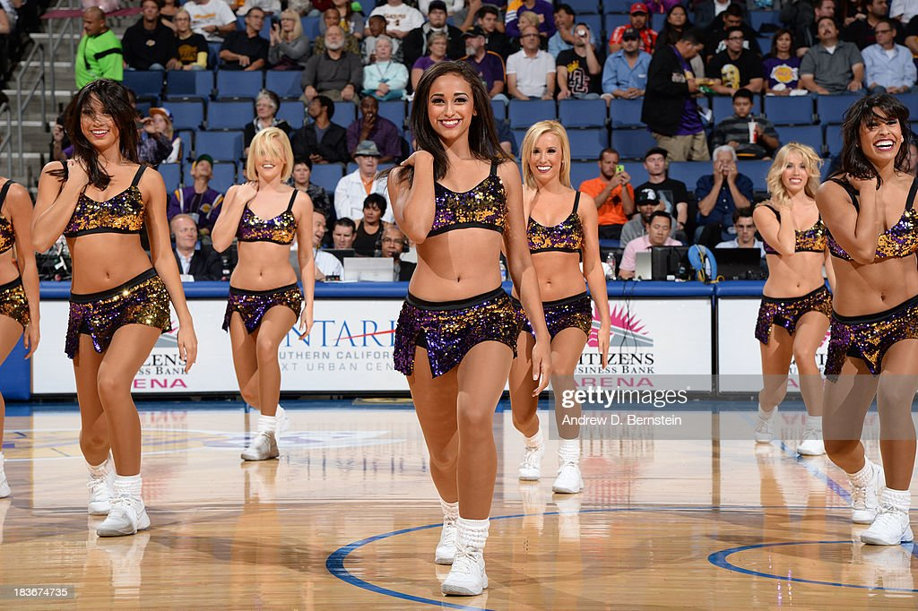 The Los Angeles Laker Girls perform during a break in the action against the Denver Nuggets at Citizens Business Bank Arena on October 8, 2013 in Ontario, California.