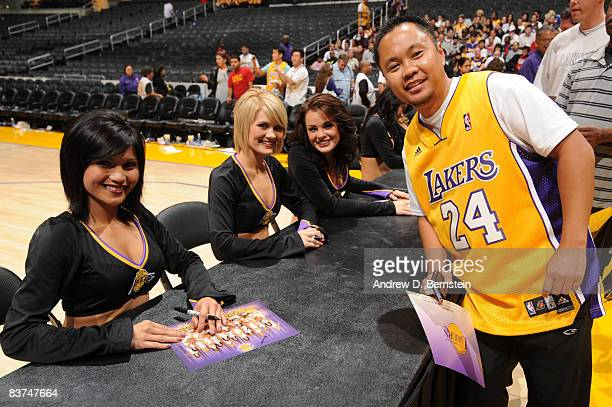 The Los Angeles Laker Girls sign autographs and pose for photos with fans who donated money to the American Red Cross Disaster Relief Fund to assist...