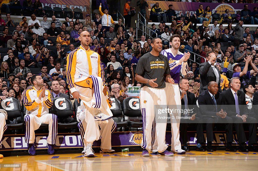 The Los Angeles Lakers bench react during a play against the Detroit Pistons at Staples Center on November 17, 2013 in Los Angeles, California.
