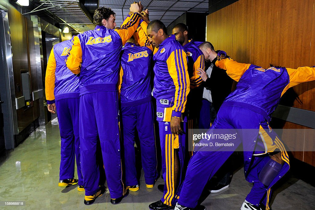 The Los Angeles Lakers huddle up in a hallway before facing the Los Angeles Clippers at Staples Center on January 4, 2013 in Los Angeles, California.