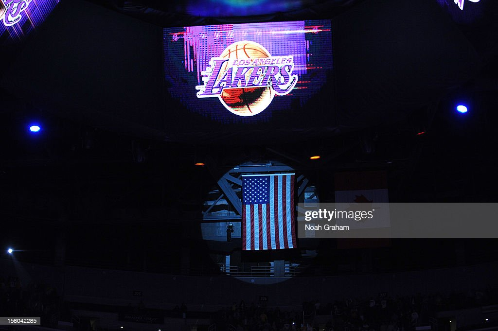 The Los Angeles Lakers logo and the American flag are spotlighted during the National Anthem before a game between the Utah Jazz and the Los Angeles Lakers at Staples Center on December 9, 2012 in Los Angeles, California.