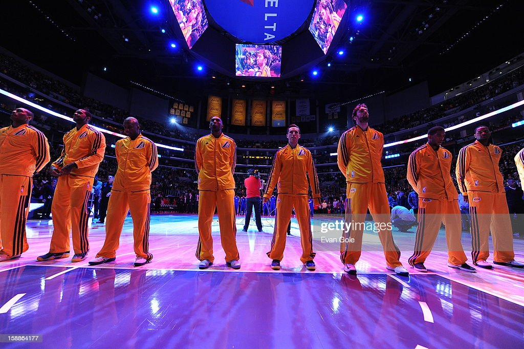 The Los Angeles Lakers players line up during the game between the Philadelphia 76ers and the Los Angeles Lakers at Staples Center on January 1, 2013 in Los Angeles, California.