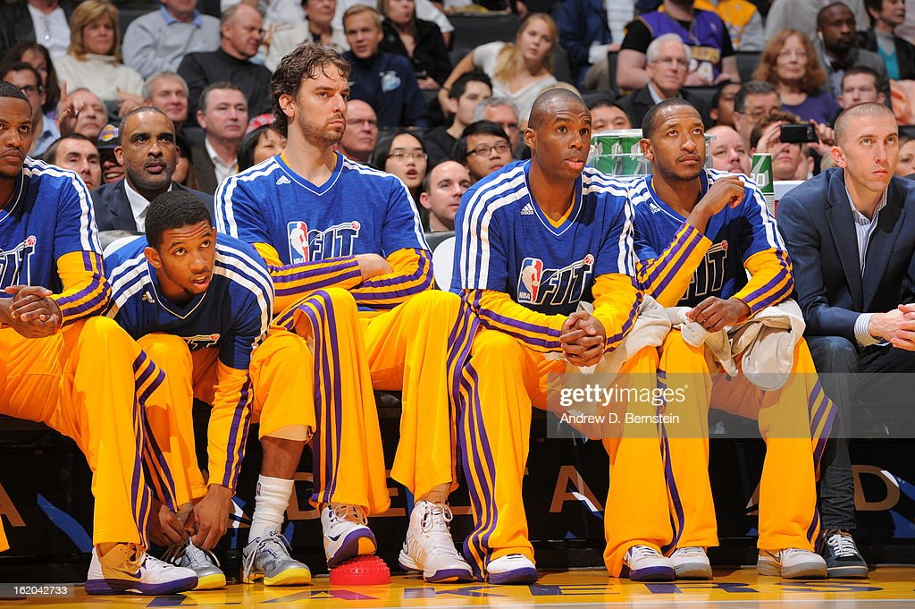 The Los Angeles Lakers sit on the bench during the game against the Utah Jazz at Staples Center on January 25, 2013 in Los Angeles, California.