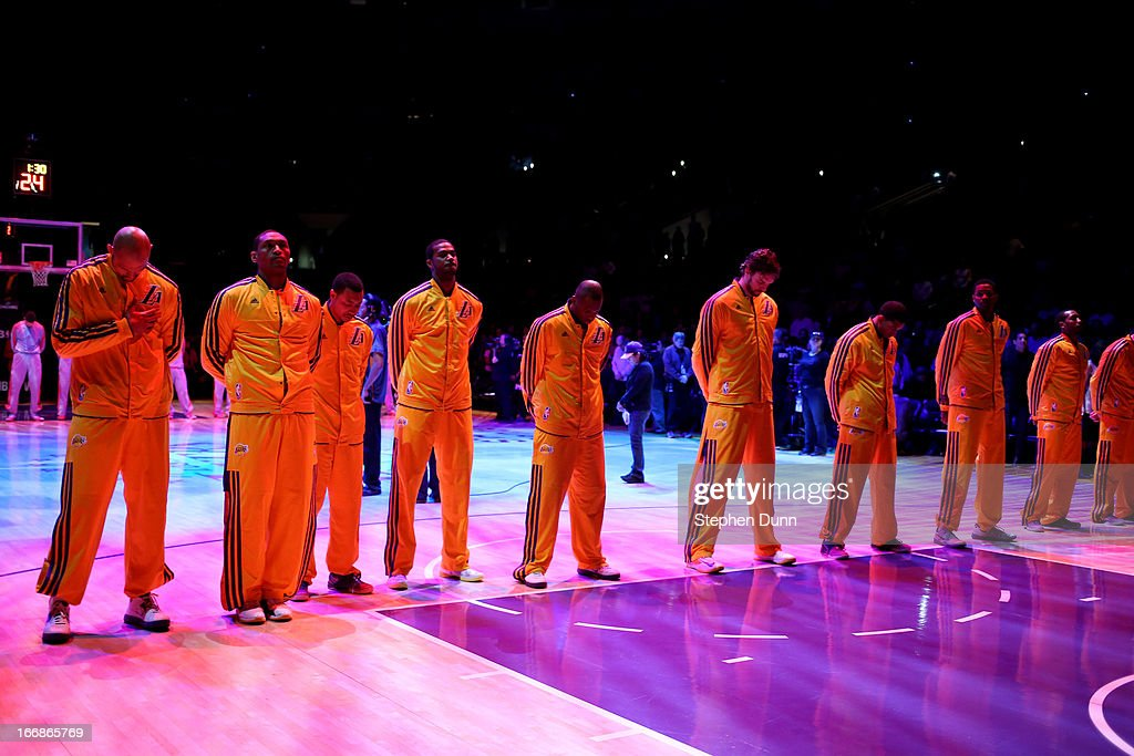 The Los Angeles Lakers stand during a moment of silence for the victims of the Boston bomb attack before the game against the Houston Rockets at Staples Center on April 17, 2013 in Los Angeles, California. The Lakers won 99-95 in overtime.