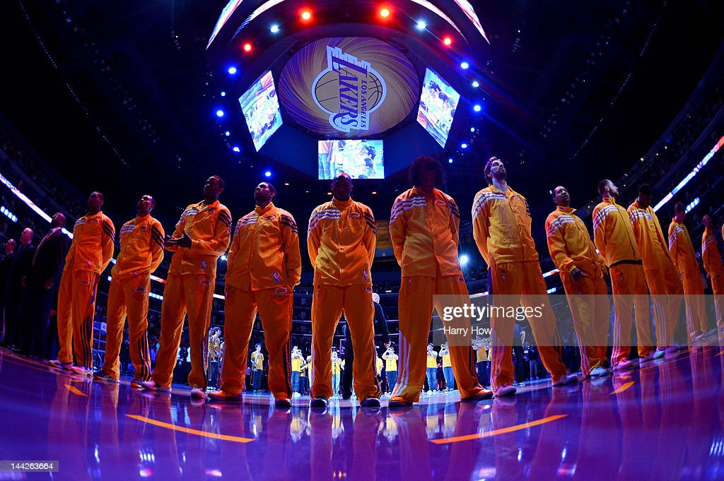 The Los Angeles Lakers stand during the national anthem before taking on the Denver Nuggets in Game Seven of the Western Conference Quarterfinals in...