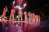The Los Angeles Lakers stand for the national anthem before a game against the Toronto Raptors at STAPLES Center on November 30 2014 in Los Angeles...