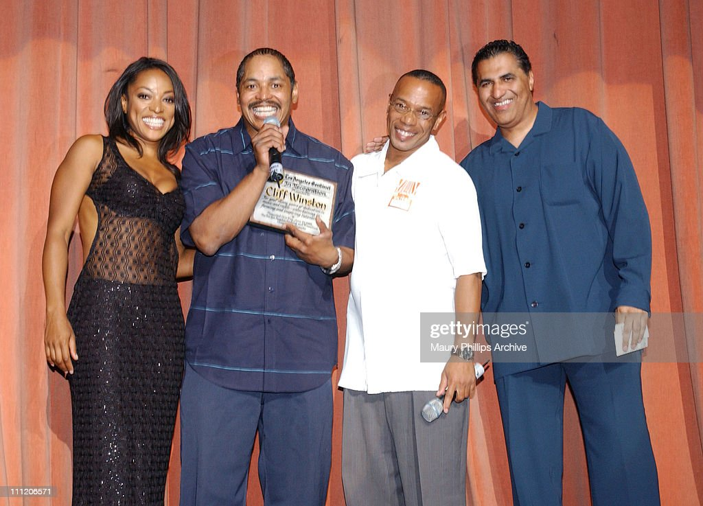 The Los Angeles Sentinel newspaper honors Cliff Winston, KJLH radio personality, for 25 years of service. L to R, Kellita Smith from 'The Bernie Mac Show', Cliff Winston, Los Angeles Sentinel Managing Editor James Bolden and Aundrae Russell, KJLH host.