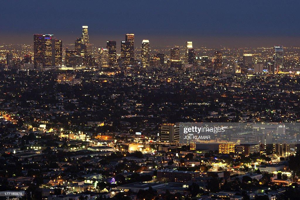 The Los Angeles skyline is seen during twilight on August 21 2013 in California AFP PHOTO /JOE KLAMAR