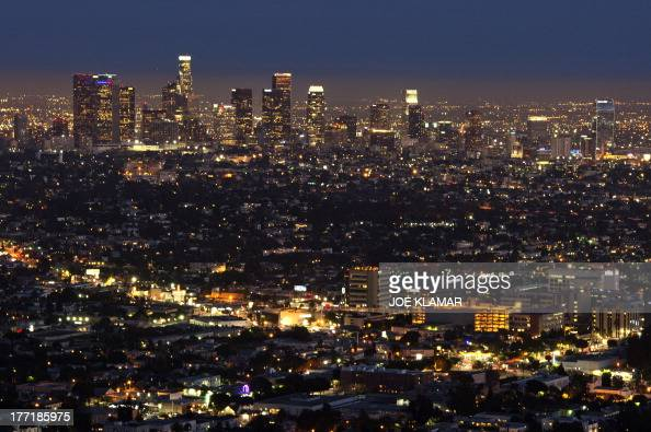The Los Angeles skyline is seen during twilight on August 21 2013 in California AFP PHOTO /JOE KLAMAR