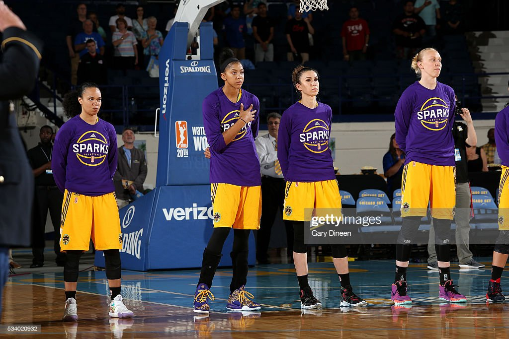 The Los Angeles Sparks stand for a moment of silence for the National Anthem before the game the Chicago Sky on May 24, 2016 at the Allstate Arena in Chicago, Illinois.