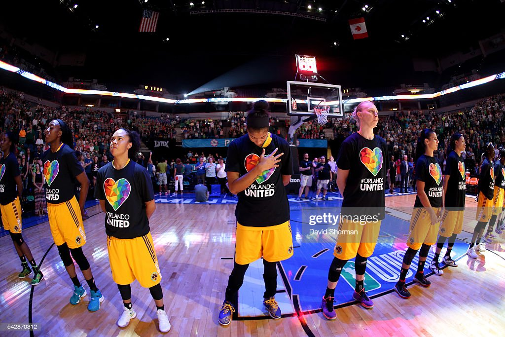 The Los Angeles Sparks stand for a moment of silence for the National Anthem before the game against the Minnesota Lynx during the WNBA game on June 24, 2016 at Target Center in Minneapolis, Minnesota.
