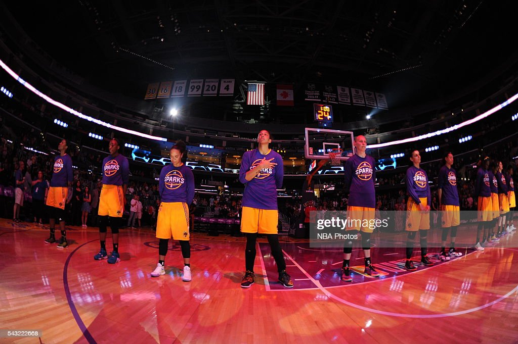 The Los Angeles Sparks stand for the national anthem before the game against the Connecticut Sun on June 26, 2016 at STAPLES Center in Los Angeles, California.