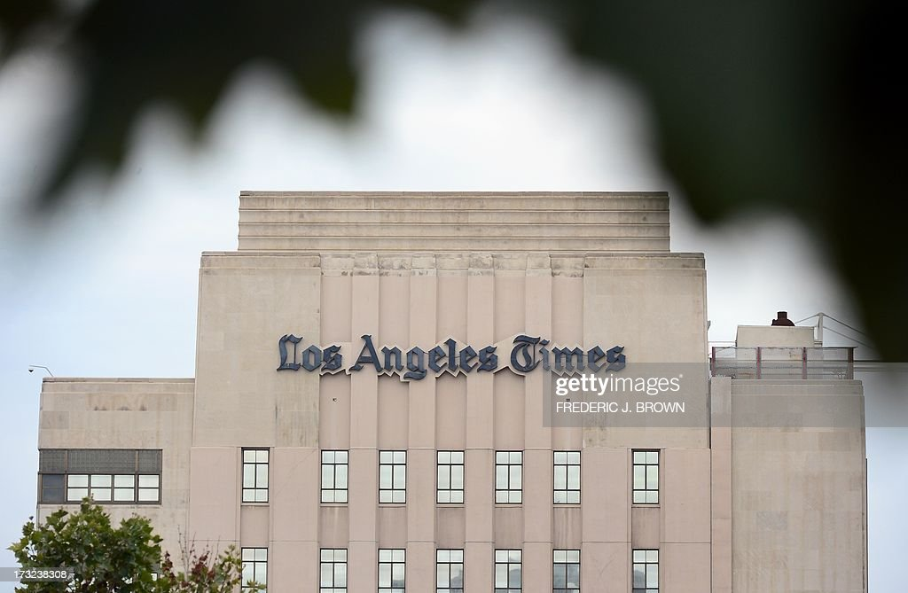 The Los Angeles Times Building in downtown Los Angeles, California on July 10, 2013. The Tribune Company, a group which owns 23 television stations, announced plans Wednesday to spin off its newspaper division, which includes the Los Angeles Times and Chicago Tribune, separating the struggling unit from its growing television station holdings. Tribune Company last week announced a $2.7 billion deal to buy 19 more local television stations and has said splitting into two distinct companies would give each 'greater financial and operational focus.' AFP PHOTO/Frederic J. BROWN