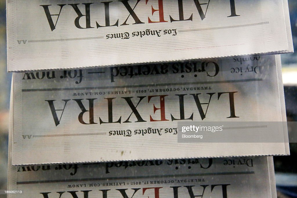 The Los Angeles Times LATEXTRA edition newspaper is printed at the Olympic Press facility in Los Angeles, California, U.S, on Wednesday, Oct. 16, 2013. Congress ended the 16-day government shutdown, raising the U.S. debt limit after the leaders of the Senate reached a bipartisan agreement to end the nation's fiscal impasse. Photographer: Patrick T. Fallon/Bloomberg via Getty Images