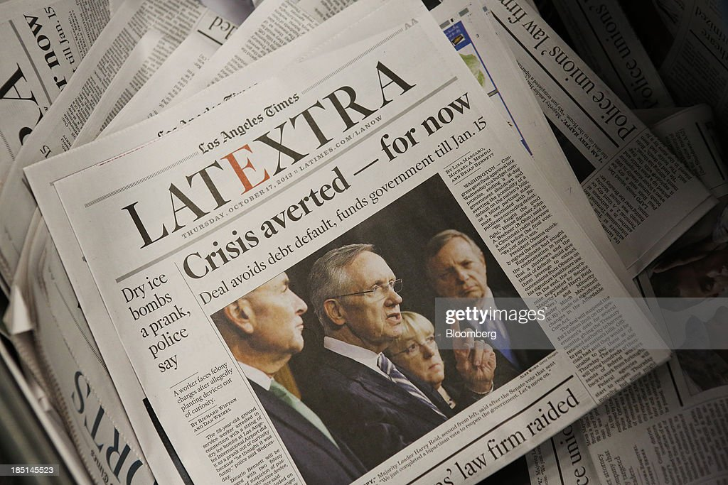 The Los Angeles Times LATEXTRA edition newspaper sits after being printed at the Olympic Press facility in Los Angeles, California, U.S, on Wednesday, Oct. 16, 2013. Congress ended the 16-day government shutdown, raising the U.S. debt limit after the leaders of the Senate reached a bipartisan agreement to end the nation's fiscal impasse. Photographer: Patrick T. Fallon/Bloomberg via Getty Images