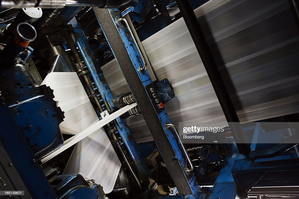 The Los Angeles Times newspaper is printed at the Olympic Press facility in Los Angeles, California, U.S, on Wednesday, Oct. 16, 2013. Congress ended the 16-day government shutdown, raising the U.S. debt limit after the leaders of the Senate reached a bipartisan agreement to end the nation's fiscal impasse. Photographer: Patrick T. Fallon/Bloomberg via Getty Images