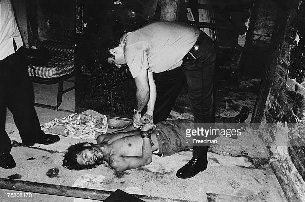 The loser of a fight between two brothersinlaw is handcuffed and taken to the Emergency Room for treatment Ninth Precinct New York City 1978...