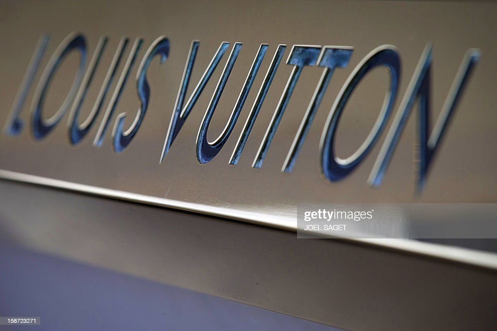 The Louis Vuitton store name is pictured above the facade of a shop, on December 26, 2012 in Paris.