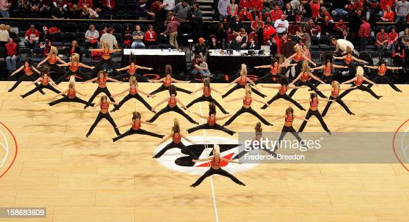 The Louisville Cardinals basketball dancers perform during halftime of a game against the Western Kentucky Hilltoppers at Bridgestone Arena on...