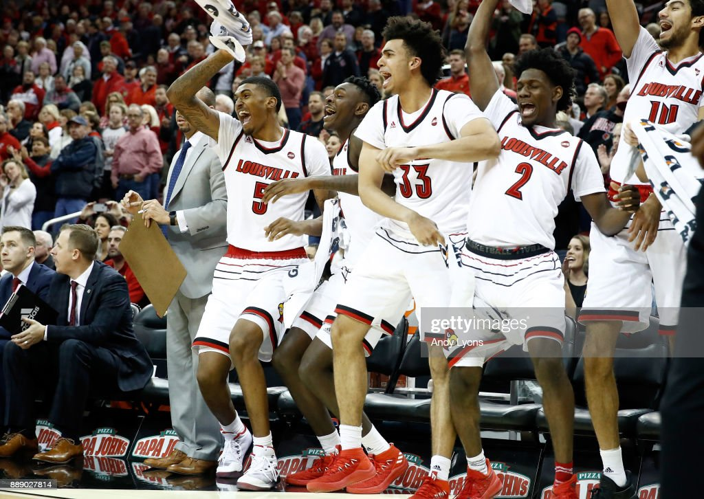 The Louisville Cardinals bench celebrates during the game against the Indiana Hoosiers at KFC YUM! Center on December 9, 2017 in Louisville, Kentucky.