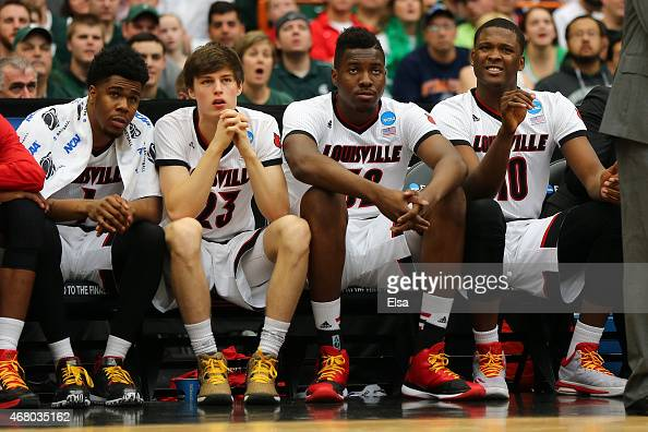 The Louisville Cardinals bench look on against the Michigan State Spartans in the second half of the game during the East Regional Final of the 2015...