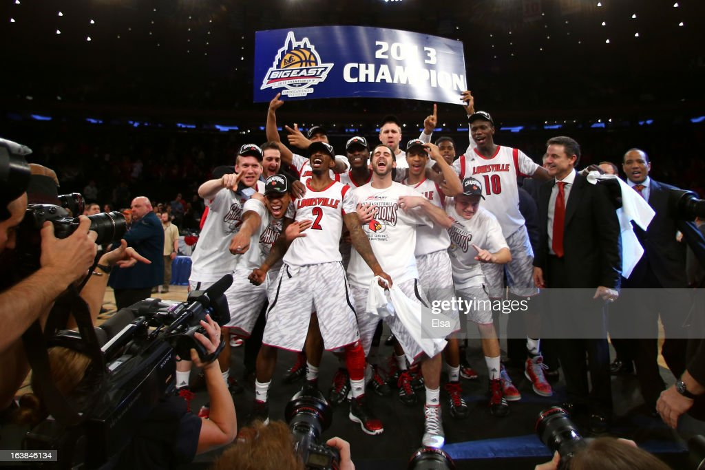 The Louisville Cardinals celebrate after they won 78-61 against the Syracuse Orange during the final of the Big East Men's Basketball Tournament at Madison Square Garden on March 16, 2013 in New York City.