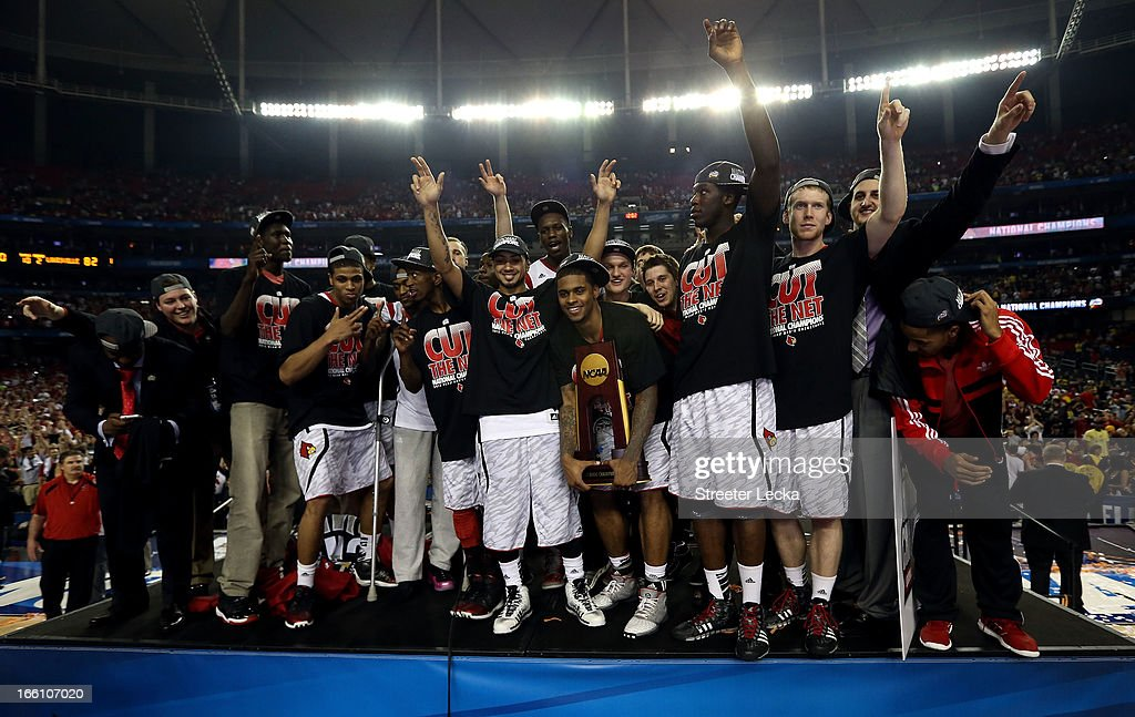 The Louisville Cardinals celebrate after they won 82-76 against the Michigan Wolverines during the 2013 NCAA Men's Final Four Championship at the Georgia Dome on April 8, 2013 in Atlanta, Georgia.