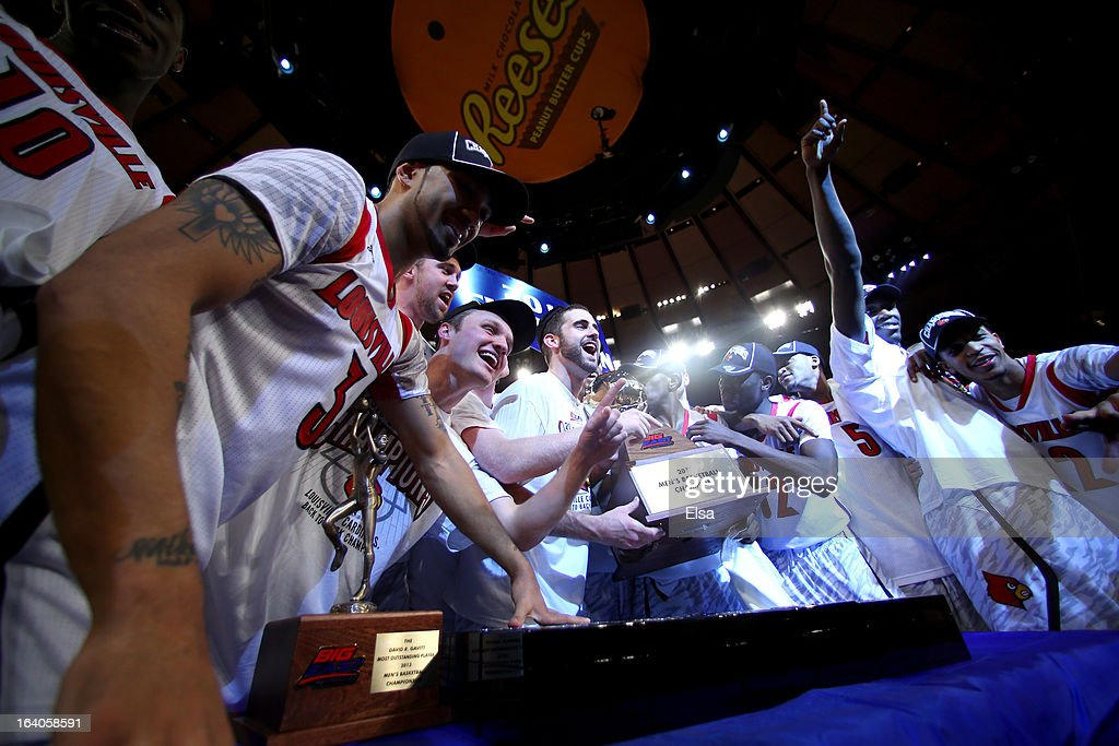 The Louisville Cardinals celebrate with the conference championship trophy after they won 78-61 against the Syracuse Orange during the final of the Big East Men's Basketball Tournament at Madison Square Garden on March 16, 2013 in New York City.