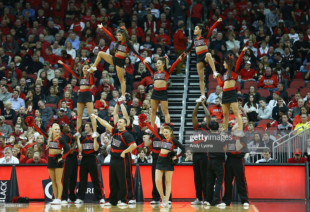 The Louisville Cardinals cheerleaders perform during the game against the Southern Mississippi Golden Eagles at KFC YUM! Center on November 29, 2013 in Louisville, Kentucky.
