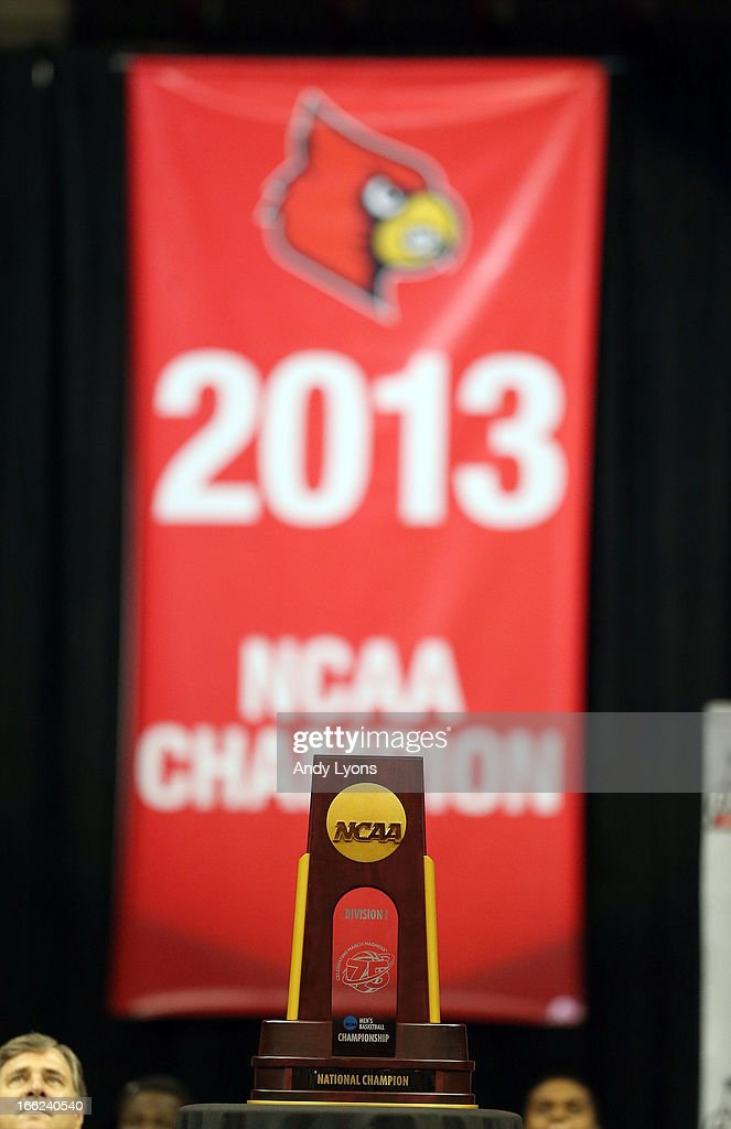 The Louisville Cardinals NCAA Championship trophy and banner are pictured during the NCAA Basketball Celebration to mark the NCAA championship by the Mens team and the runner-up finish by the womens team at KFC YUM! Center on April 10, 2013 in Louisville, Kentucky.