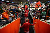 The Louisville Cardinals take the court prior to the game against the North Carolina State Wolfpack during the East Regional Semifinal of the 2015...
