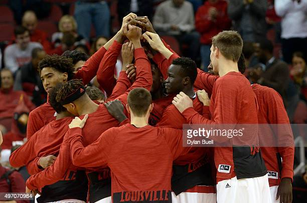 The Louisville men's basketball team huddles before the game against the Samford Bulldogs at KFC YUM Center on November 13 2015 in Louisville Kentucky