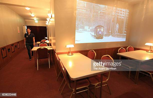 The lounge is equipped with tables and chairs that were used in the retired sleeper's dining room at The Train Hostel Hokutosei on December 1 2016 in...