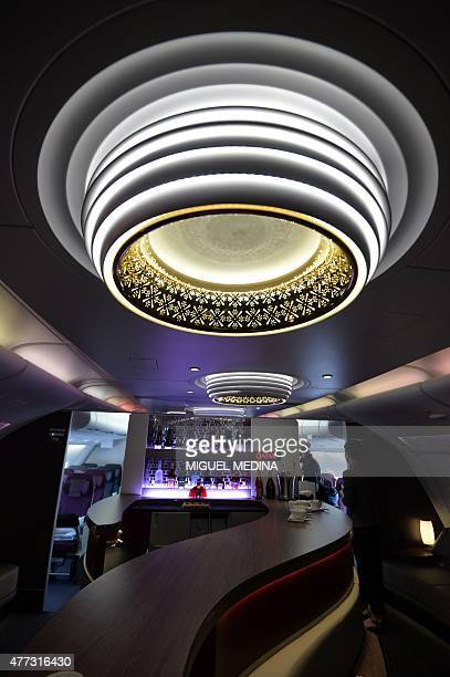 The lounge of the first and business class of an Airbus A380 of Qatar Airways is pictured at Le Bourget airport on June 16 north of Paris on the...